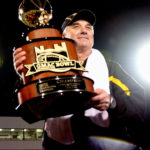 Southern Miss head coach Jeff Bower holds the GMAC Bowl trophy after the  Golden Eagles defeated Ohio 28-7.