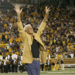 TIM ISBELL/SUN HERALD Southern Miss legend and recent NFL Hall of Fame Inductee, Ray Guy, waves to Southern Miss fans during halftime show at USM -Rice game.