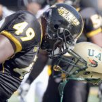 TIM ISBELL/SUN HERALD In the spirit of Halloween Southern Miss linebacker Cordarro Law looks like he beheaded at UAB player, coming up with nothing but a helmet. Law got hit helmet hooked up with Matt McCants of UAB during the first quarter.