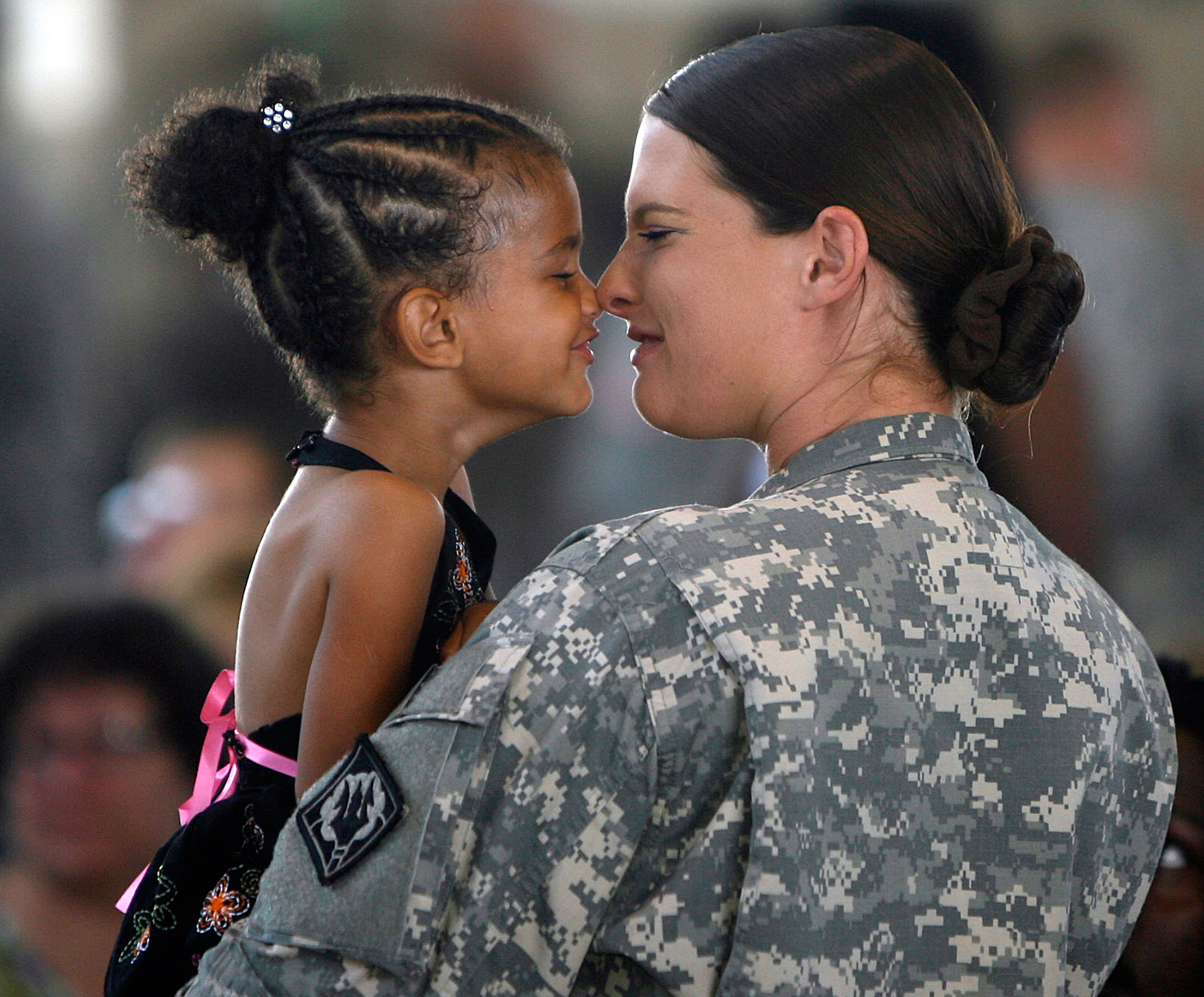 Mother and daughter say goodbye as mother is deployed overseas.