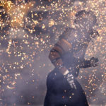 TIM ISBELL/SUN HERALD Southern Miss defensive lineman LaDarius Harris runs through a field of sparks as the Golden Eagles take the field, Saturday, Oct. 17, 2015.