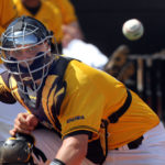 TIM ISBELL/SUN HERALD Southern Miss catcher Jared Bales of Picayune was named to the C-USA All-Freshman Team. watches the ball come in from right field as he attempts to catch and tag a Tulane base runner. Tulane scored on the play.
