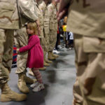 Lindey Bryant wades through a sea of desert camo to hug the leg of her   father 1st Lt. Michael Bryant Sunday morning as members of the Headquarters   Company 890th Engineer Battalion returned from a year tour of duty in Iraq.   The three-year-old Bryant couldn't wait to get her father back home in   Purvis, Miss.