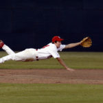 Mike Wilson dives for a ground ball against Oak Grove.
