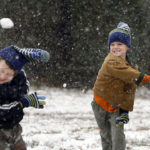 TIM ISBELL/SUN HERALDGaines Cleveland (left) ducks a snowball thrown by Nelson Cleveland at Paul B. Johnson State Park south of Hattiesburg. When the snow didn't come to the Coast, many resident drove north to the snow.