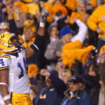 LSU receiver Michael Clayton shows LSU fans who is Number 1 after scoring  the game winning touchdown against the Ole Miss Rebels.